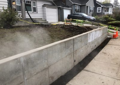 7717 SE 17TH AVE RETAINING WALL ROUGH FINISH