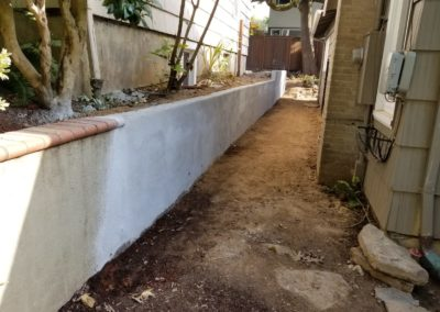 STUCCO FINISH RETAINING WALL